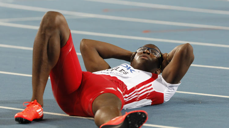 Cuba's Dayron Robles lies on the track after crossing the finish line first in the Men's 110m Hurdles final at the World Athletics Championships in Daegu, South Korea, Monday, Aug. 29, 2011. Robles finished first but was later disqualified for making contact with China's Liu Xiang. (AP Photo/Anja Niedringhaus)