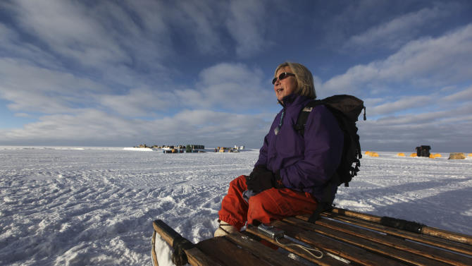 This Friday, July 15, 2011 picture shows Liz Morris, 64, of Cambridge University's Scott Polar Research Institute, at Summit Station, a small research facility situated 10,500 feet above sea level, on top of the Greenland ice sheet, days before a month-long, 500-mile research trip via snowmobile. Morris' research trip is funded by Britain's National Environmental Research Council and mounted with the U.S. National Science Foundation's cooperation. In 2003, Queen Elizabeth honored the intrepid Morris with a Polar Medal, given in recognition of distinguished service in Arctic and Antarctic exploration. Three years earlier the monarch inducted her into the Order of the British Empire. (AP Photo/Brennan Linsley)