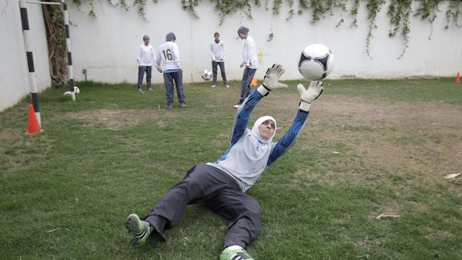 In this May 21, 2012 photo, Mawada Chaballout, a 27-year-old American member of a Saudi female soccer team practices at a secret location in Riyadh, Saudi Arabia. While Olympic leaders and human rights advocates are encouraged by signs that Saudi Arabia may bow to pressure and send female athletes to the Summer Games, women athletes in the ultraconservative kingdom are worried about a backlash at home.(AP Photo/Hassan Ammar)