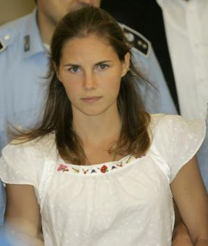 FILE - In this Tuesday Sept. 16, 2008 file photo, American murder suspect Amanda Knox is escorted by Italian penitentiary police officers from Perugia's court after a hearing, central Italy. Italian prosecutors have appealed to Italy's highest criminal court a decision throwing out the murder conviction against Amanda Knox and her former Italian boyfriend in the brutal slaying of a British student. Perugia prosecutors filed the 111-page appeal on Tuesday, Feb. 14, 2012, more than four months after an appeals court in Perugia threw out murder convictions against Knox and Raffaele Sollecito. Knox and Sollecito were convicted in a lower court of murdering Knox's British roommate in what prosecutors described as a sex-fueled attack. An appeals court said the evidence did not hold up. (AP Photo/Antonio Calanni, File)