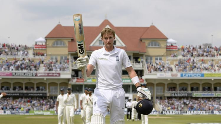 England's Root leaves the field after scoring 154 not out during the first cricket test match against India at Trent Bridge cricket ground in Nottingham