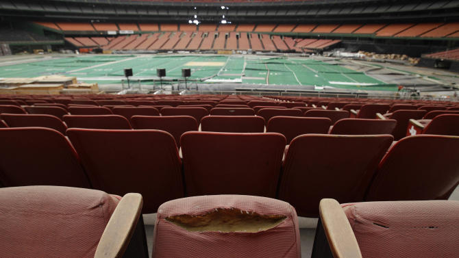 FILE - In this May 21, 2012, file photo, rows of dirty, tattered seats ring the Astrodome in Houston. Once touted as the Eighth Wonder of the World, the nation's first domed stadium sits quietly gathering dust and items for storage. The National Trust for Historic Preservation put the Astrodome on its 2013 list of 11 Most Endangered Historic Places. The Astrodome was the world's first domed, air-conditioned stadium and needs a viable plan to be reused to avoid demolition. (AP Photo/Pat Sullivan, File)