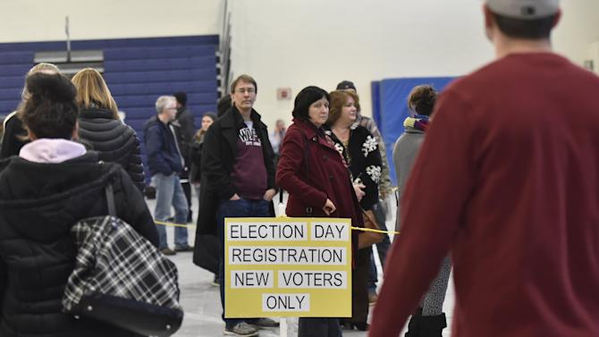 New voters line up to register in the New Hampshire primary at Londonderry High School in Londonderry