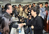 Park Geun-Hye (R), presidential candidate of the ruling conservative New Frontier Party, meets journalists in Seoul in April 2012. Park, 60, is the daughter of Park Chung-Hee, the military strongman who seized power in a coup in 1961 and was assassinated by his spy chief in 1979