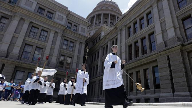 Anti-abortion supporters take part in a rosary procession around the Texas Capitol as the Texas House debates HB 2, a bill that will place restrictions on abortion in the state, Tuesday, July 9, 2013, in Austin, Texas. (AP Photo/Eric Gay)