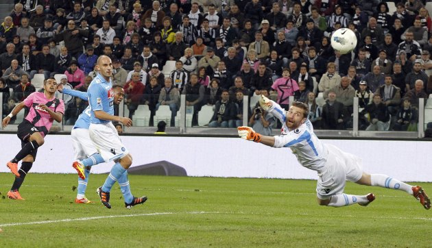Juventus' Arturo Vidal shoots and scores past Napoli goalkeeper Morgan De Sanctis during their Italian Serie A soccer match in Turin