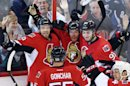 Ottawa Senators Daniel Alfredsson (11) celebrates with teammates Milan Michalek (9), Sergei Gonchar (55) and Mika Zibanejad (93) in the third period of game four of the Eastern Conference Stanley Cup semi-final NHL hockey action on Sunday May 19, 2013 in Ottawa. (AP Photo/The Canadian Press, Fred Chartrand)