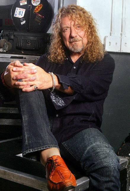"""FILE - This July 30, 2010 file photo shows singer Robert Plant posing at Bayfront Amphitheatre in Miami. Plant will headline at the Sunflower River Blues and Gospel Festival in Clarksdale, Miss. The festival runs Friday through Sunday and will also include performances by multiple Grammy-nominated bluesman Charlie """"Memphis Charlie"""" Musselwhite and blues great Bobby Rush.  (AP Photo/Carlo Allegri, file)"""