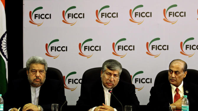 Iranian Energy Minister Majid Namjoo, center, speaks as Federation of Indian Chambers of Commerce and Industry President, R. V. Kanoria, right, and Iranian Ambassador to India Sayed Mehdi Nabizadeh, left, listen during an interactive business meeting with FICCI members in New Delhi, India, Wednesday, Oct. 10, 2012. (AP Photo/Altaf Qadri)