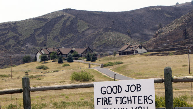 A sign thanking firefighters is attached to a fence of a home that was surrounded by the High Park wildfire near Bellvue,  Colo., on Monday,  June 18, 2012. The fire has now burned about 90 square miles and destroyed more than 180 homes. (AP Photo/Ed Andrieski)