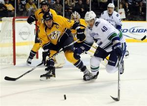 Canucks beat Predators 4-3 in SO