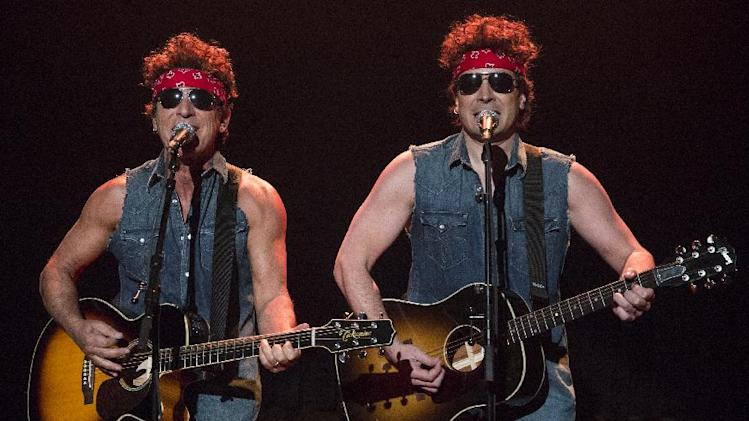 "This image released by NBC shows Bruce Springsteen, left, and Jimmy Fallon performing during ""Late Night with Jimmy Fallon,"" on Tuesday, Jan. 14, 2014, in New York. (AP Photo/NBC, Lloyd Bishop)"