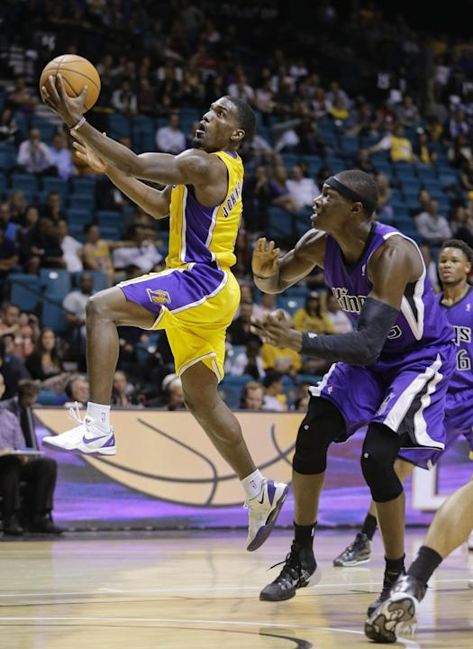 Los Angeles Lakers shooting guard Darius Johnson-Odom (6) puts up a layup against Sacramento Kings center Hamady Ndiaye (55) in the fourth quarter of a preseason NBA basketball game, Thursday, Oct. 10
