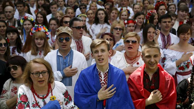 """People dressed in traditional Ukrainian clothing vyshyvanka sing national anthem as they take part in """"March in vyshyvankas"""" in Kiev"""