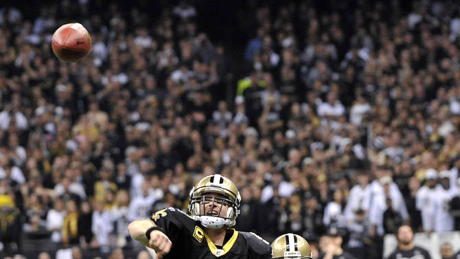 New Orleans Saints quarterback Drew Brees (9) throws a touchdown pass to tight end Jimmy Graham in the second quarter of an NFL football game against the Atlanta Falcons in New Orleans, Monday, Dec. 26, 2011. (AP Photo/Bill Feig)