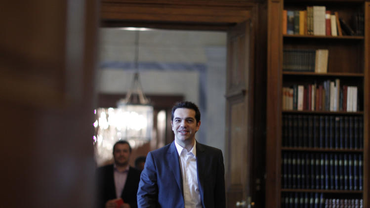 Greek leader of Coalition of the Radical Left party (SYRIZA)  Alexis Tsipras arrives  a meeting with Greek President Karolos Papoulias, to formally take the mandate to form a coalition government in Athens, on Tuesday, May 8, 2012. Bailout-reliant Greece faces days, possibly weeks, of political instability after voters angry at crippling income cuts punished mainstream politicians, let a far-right extremist group into Parliament but gave no party enough votes to govern alone.  (AP Photo/Kostas Tsironis, pool)