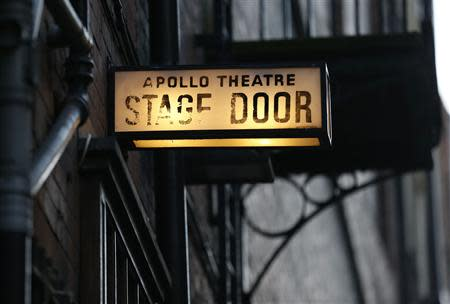 The stage door light is seen at the back of the Apollo theatre on the morning after part of it's ceiling collapsed on spectators as they watched a performance, in central London