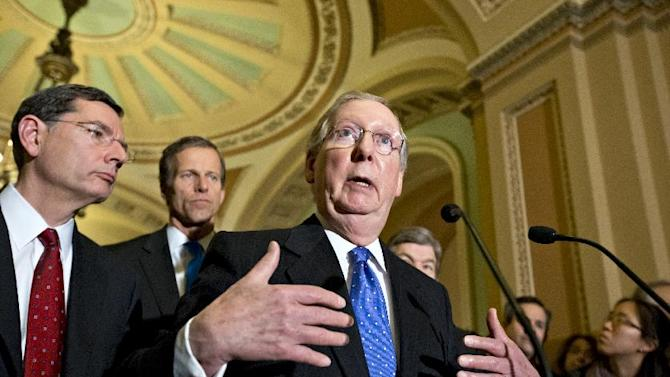 Senate Minority Leader Mitch McConnell of Ky., right, gestures as he speaks with reporters on Capitol in Washington, Tuesday, Nov. 27, 2012, following a GOP strategy luncheon. From left are, Sen. John Barrasso, R-Wyo., Sen. John Thune, R-S.D., and McConnell.  (AP Photo/J. Scott Applewhite)