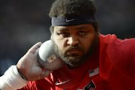 US&#39; Reese Hoffa competes in the men&#39;s shot put qualifying rounds at the athletics event during the London 2012 Olympic Games in London. British poster-girl Jessica Ennis made a flying start to the heptathlon as the London Games athletics programme got under way in front of a vocal, 80,000-capacity Olympic Stadium crowd