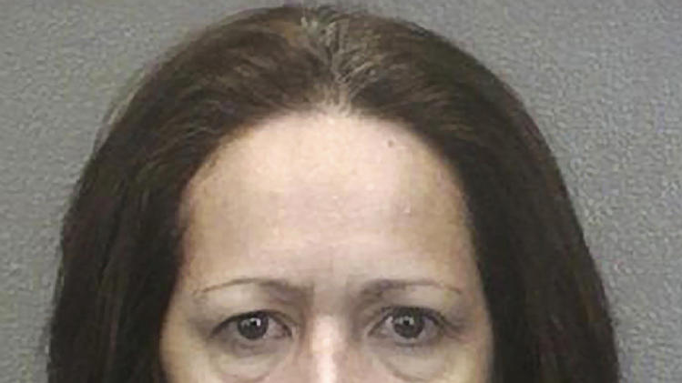 Fla. woman gets life in prison in family killings