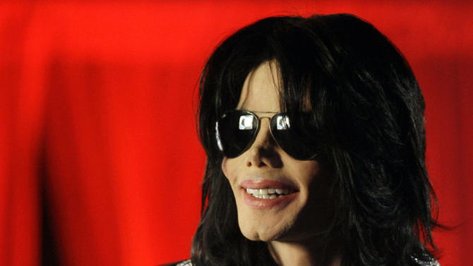 """FILE - In this March 5, 2009 file photo, Michael Jackson speaks at a news conference in London. AEG Live LLC CEO Randy Phillips told a jury Wednesday June 12, 2013 that they have heard an inaccurate portrait of Jackson during an ongoing civil trial, and said the entertainer was a sophisticated businessman and not a """"drug-addled 5-year-old."""" The company and Phillips are being sued by Jackson's mother, claiming they did not properly investigate the doctor convicted of causing her son's death in 2009. (AP Photo/Joel Ryan, File)"""