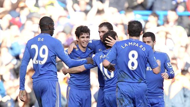 Oscar, second left, celebrates after scoring Chelsea&#39;s second goal of the game against Brentford
