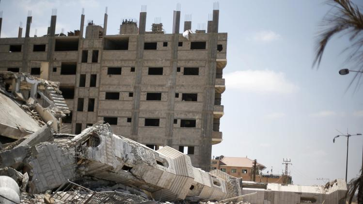 The damaged minaret of a mosque is seen during Friday prayers in Gaza City