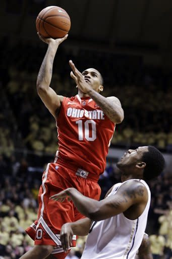 Thomas leads No. 15 Buckeyes past Purdue 74-64