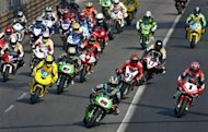 This file photo, released by Macau Grand Prix Committee, shows riders competing during the Macau Motorcycle GP, in 2007. A driver in the CTM Macau Touring Car Cup was killed in the second fatality to mar the Macau Grand Prix in two days