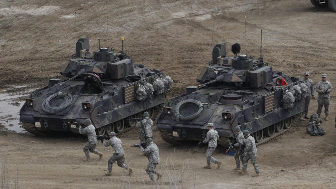 U.S. Army soldiers conduct their annual military drills in Yeoncheon, South Korea, near the border with North Korea, Thursday, April 11, 2013.  This year's drills are unusual in the level of fury they've inspired from the North — Pyongyang has threatened nuclear war — and in the tougher than usual U.S. response that some call a case of Washington overplaying its hand.   (AP Photo/Ahn Young-joon)