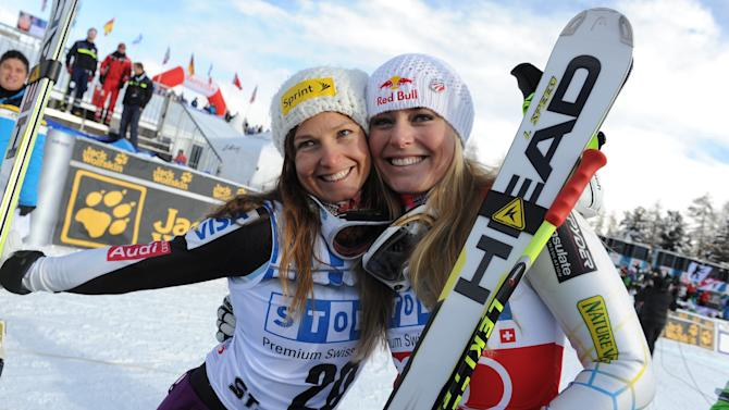 Lindsey Vonn, right, of the United States, celebrates with her teammate third placed Julia Mancuso after winning an alpine ski, women's World Cup super-G, in St. Moritz, Switzerland, Saturday, Dec .8, 2012. (AP Photo/Giovanni Auletta)