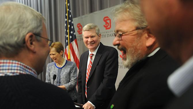 S.D. Senator Tim Johnson is greeted by well wishers after announcing Tuesday, March 26, 2013 his retirement from the U.S. Senate after his term ends in early 2015 at the Al Neuharth Media Center in Vermillion, S.D. (AP Photo/Argus Leader, Jay Pickthorn)