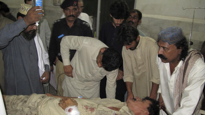 A Pakistani man who was injured in a suicide bombing at a residence of a provincial government minister, receives treatment at a hospital in Dera Ismail Khan, Pakistan, Wednesday, Oct. 16, 2013. A suicide bomber shot his way into the residence of a provincial government minister Wednesday in northwestern Pakistan, killing the official and several others in an explosion, police said. (AP Photo/Ishtiaq Mahsud)