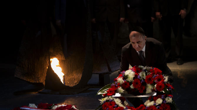 Azerbaijan's Foreign Minister Elmar Mammadyarov lays a wreath at the Hall of Remembrance at the Yad Vashem Holocaust memorial in Jerusalem, Monday, April 22, 2013. Israel's president on Monday praised Azerbaijan for playing a key role in countering Iran's influence in the Middle East as the Muslim country's foreign minister visited the Jewish state for the first time. (AP Photo/Bernat Armangue)