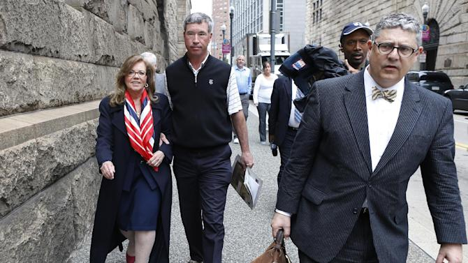 Former state Supreme Court Justice Joan Orie Melvin, left, leaves court with her husband Greg Melvin, center, and defense attorney Patrick Casey, right, after she and her sister, Janine Orie,  were sentenced for their February convictions on corruption in Orie Melvin's election campaign, on Tuesday, May 7, 2013, in Pittsburgh. The sisters avoided prison time but were sentenced to house arrest for what a judge called crimes of arrogance. (AP Photo/Keith Srakocic)