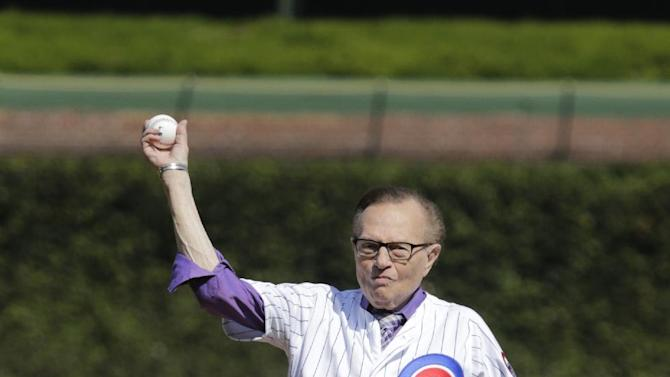 Radio and Television personality Larry King throws out a ceremonial first pitch before a baseball game between the Chicago Cubs and the Los Angeles Dodgers Friday, Sept. 19, 2014, in Chicago. (AP Photo/Charles Rex Arbogast)