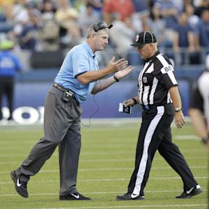 FILE - This Aug. 11, 2012 file photo, shows Tennessee Titans head coach Mike Munchak, left, arguing with a replacement official in the first half of an NFL football preseason game against the Seattle Seahawks, in Seattle. The NFL will open the regular season with replacement officials. League executive Ray Anderson has told the 32 teams that with negotiations remaining at a standstill between the NFL and the officials' union. The replacements will be on the field beginning next Wednesday night when the Cowboys visit the Giants to open the season. (AP Photo/Rick Bowmer, File)