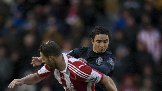 Manchester United's Rafael, right, fights for the ball against Stoke's Erik Pieters during their English Premier League soccer match at the Britannia Stadium, Stoke, England, Saturday Feb. 1, 2014