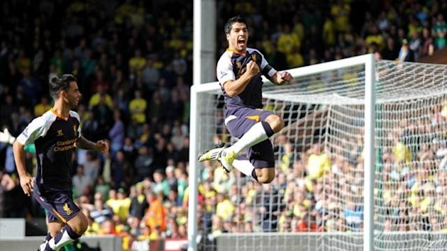 Liverpool&#39;s Luis Suarez celebrates scoring against Norwich