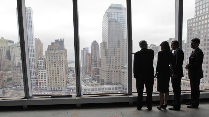 British Prime Minister David Cameron, second from left, and his wife Samantha, second from right, look over the World Trade Center site during a tour of the 21st floor of the 1 World Trade Center with Port Authority of NY and NJ Executive Director Patrick J. Foye, left, and Deputy Executive Director Bill Baroni, Thursday, March 15, 2012 in New York. (AP Photo/Mary Altaffer, Pool)