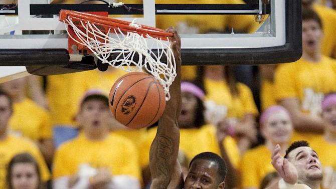 Missouri's Keion Bell, left, dunks the ball past Northwest Missouri State's Matt Wallace, right, and Grant Cozad (45) during the second half of an NCAA college basketball exhibition game, Monday, Oct. 29, 2012, in Columbia, Mo. Missouri won 91-58. (AP Photo/L.G. Patterson)
