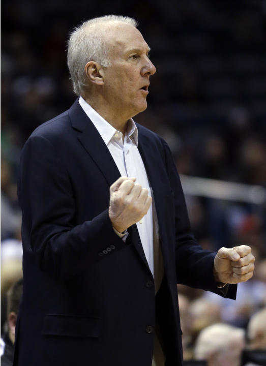 San Antonio Spurs head coach Gregg Popovich reacts to a call during the first half of an NBA basketball game against the Milwaukee Bucks Wednesday, Dec. 11, 2013, in Milwaukee