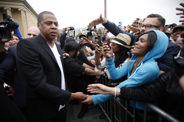 "Entertainer Shawn ""Jay-Z"" Carter meets with fans after a news conference at the  Philadelphia Museum of Art, Monday, May 14, 2012, in Philadelphia. The rapper announced plans for a two-day music festi"