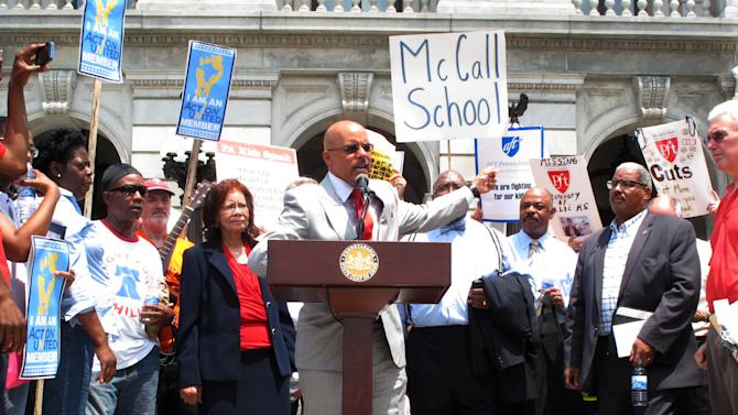 Sen. Vincent Hughes, D-Philadelphia, speaks at a rally to press Gov. Tom Corbett and Republicans who control the state Legislature for more public school funding on the steps of the Pennsylvania Capitol, Tuesday, June 25, 2013, in Harrisburg, Pa. The rally was attended by hundreds of school employees, including some just laid off by the Philadelphia School District. (AP Photo/Marc Levy)