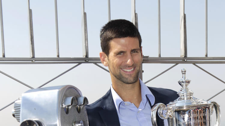 Novak Djokovic, of Serbia, smiles at the top of the Empire State Building in New York, Tuesday Sept. 13, 2011. Djokovic defeated Rafael Nadal Sunday to win his first U.S. Open tennis championship and third Grand Slam trophy of the year. (AP Photo/Seth Wenig)