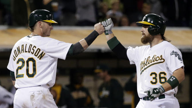 Norris, Vogt homer as A's beat Twins 12th in a row