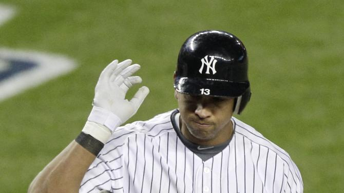 New York Yankees' Alex Rodriguez reacts after striking out in the sixth inning during Game 1 of the American League championship series against the Detroit Tigers Saturday, Oct. 13, 2012, in New York. (AP Photo/Kathy Willens)