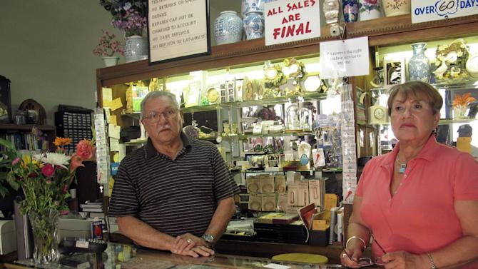 Guillermo and Betty Garcia stand in their downtown Stockton, Calif., clock and jewelry shop Wednesday, June 27, 2012. Garcia said the Stockton bankruptcy will have a trickle effect on residents and business owners, including a rise in crime and more businesses going belly up. (AP Photo/Gosia Wozniacka)