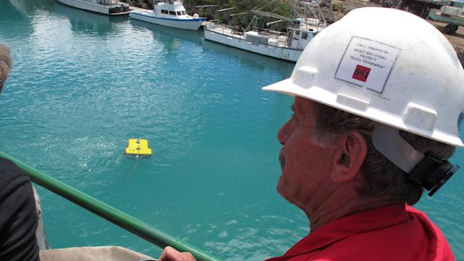 Wolfgang Burnside controls a remote-operated vehicle from the deck of a ship in Honolulu on Sunday, July 1, 2012. Cameras and lights on the vehicle will be used to search the ocean floor during a month-long voyage to find plane wreckage from Amelia Earhart's Lockheed Electra, which disappeared over the South Pacific 75 years ago. (AP Photo/Oskar Garcia)