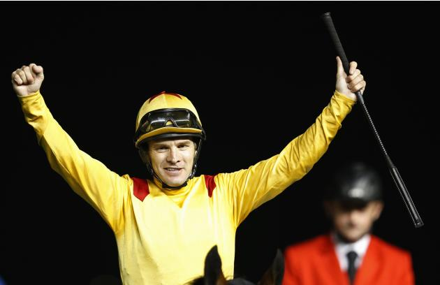 "Mullen, riding Reynaldothewizard of the U.S., celebrates after winning the sixth race ""Dubai Golden Shaheen"" during the Dubai World Cup at the Meydan Racecourse in Dubai"